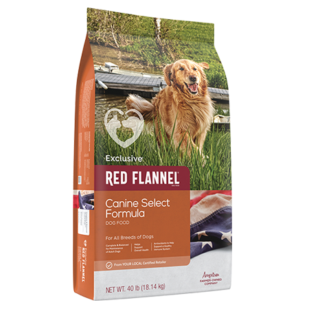 Red Flannel Canine Select Dog Food. Tan pet food bag. Features adult dog.