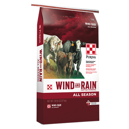 Purina Wind and Rain All Season Minerals. Red and white feed bag. Features cattle.