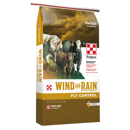 Purina Wind and Rain Fly Control. Gold and white bag. Features cattle.