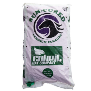 White feed bag with logo. Premium forage replacement cubes. Alfalfa cubes for cattle, horses, elk, and more.