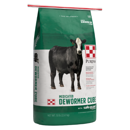 Green and white 50-lb feed bag. Black cow. Purina Safe Guard Cattle Dewormer.